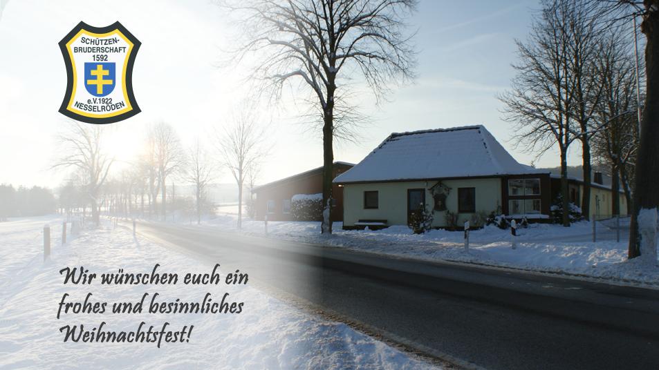 Weihnachtsgruß der Schützenbruderschaft Nesselröden. Foto des Schützenhauses Nesselröden im Winter.